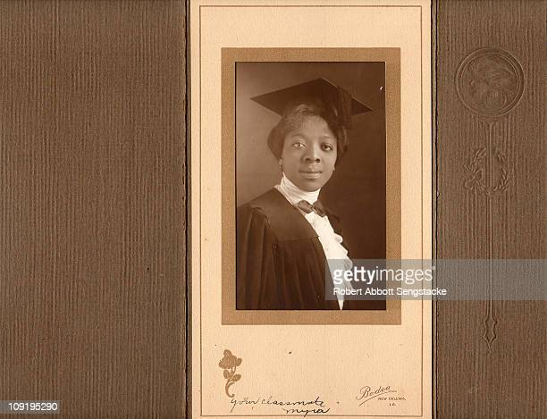 Carte de visite shows an unidentified young woman in a graduate's cap and gown 1914 The inscription reads 'Your Classmate Myra'
