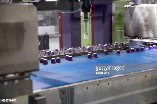 Carte Noire Espresso Puissant coffee capsules move along a conveyor on the production line inside the Carte Noire factory in Laverune France on...