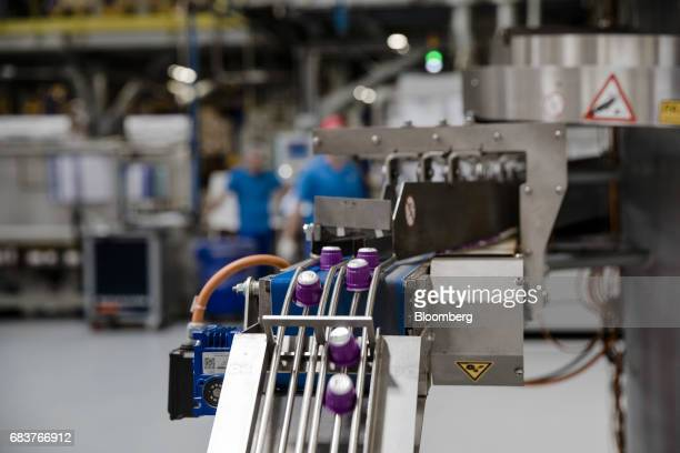 Carte Noire Espresso Puissant coffee capsules move along a machine ready to be sorted ahead of packaging on the production line inside the Carte...