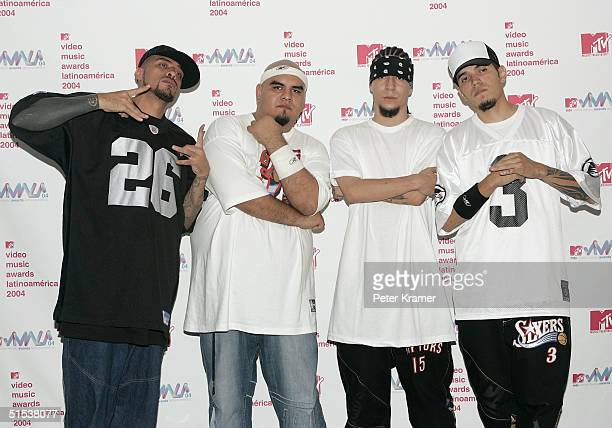 Cartel de Santa poses backstage in the press room at the 2004 MTV Video Music Awards Latin America at the Jackie Gleason Theater October 21 2004 in...