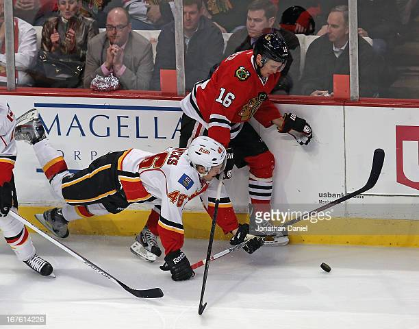 Carter Bancks of the Calgary Flames hits the ice as he battles with Marcus Kruger of the Chicago Blackhawks at the United Center on April 26 2013 in...