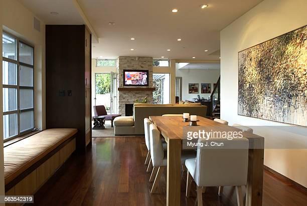 Carter Bravmann's New Modernist house features walnut hardwood flooring an European oak dining table and solar cells providing most of the home's...