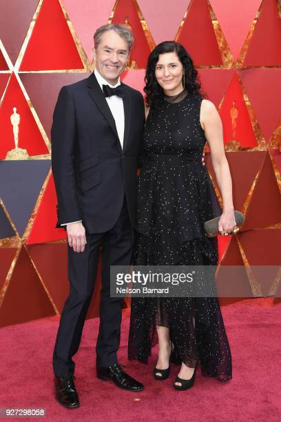 Carter Burwell and Christine Sciulli attend the 90th Annual Academy Awards at Hollywood Highland Center on March 4 2018 in Hollywood California
