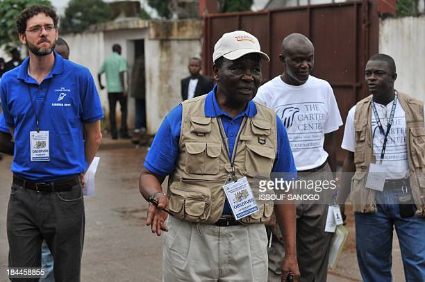 Carter Center Observer Chief, former Nigerian President general Yakubu Gowon arrives at a polling station during the vote for Presidential,...