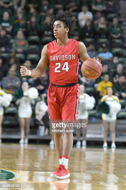 Carter Collins of the Davidson Wildcats dribbles up court during a college basketball game against the George Mason Patriots at the Eagle Bank Arena...