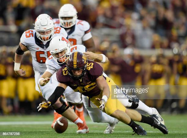 Carter Coughlin of the Minnesota Golden Gophers and Jeff George Jr #3 of the Illinois Fighting Illini go after a loose ball during the fourth quarter...