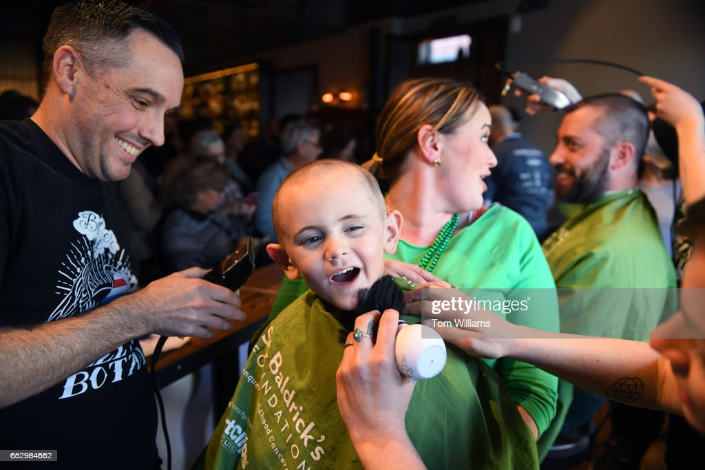 Carter Furey, 4, of Germantown, Md., who is in remission from Retinoblastoma, gets his head shaved during a St. Baldrick's event at Boundary Stone pub to raise money to fight childhood cancer, March 12, 2017. Retinoblastoma is cancer that effects the eye.