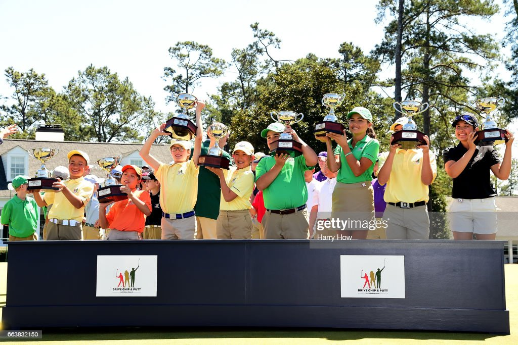 Carter Gaede, Maye Huang, Liam Hartling, Lucy Yuan, Zachary Colon, Alexa Pano, Mason Quagliata and Savannah Grewal pose with trophies for their overall wins during the Drive, Chip and Putt Championship at Augusta National Golf Club on April 2, 2017 in Augusta, Georgia.