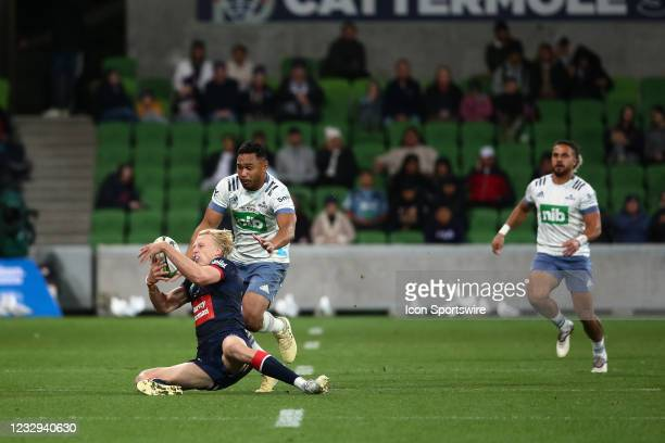 Carter Gordon of the Melbourne Rebels gets tackled during round one of the Super Rugby Trans Tasman match between the Melbourne Rebels and Blues at...