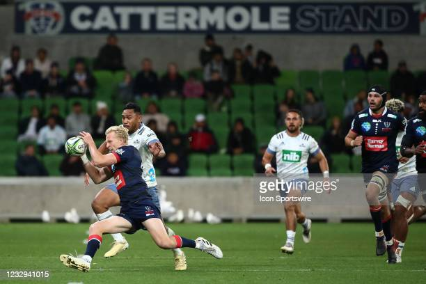 Carter Gordon of the Melbourne Rebels runs the ball during round one of the Super Rugby Trans Tasman match between the Melbourne Rebels and Blues at...