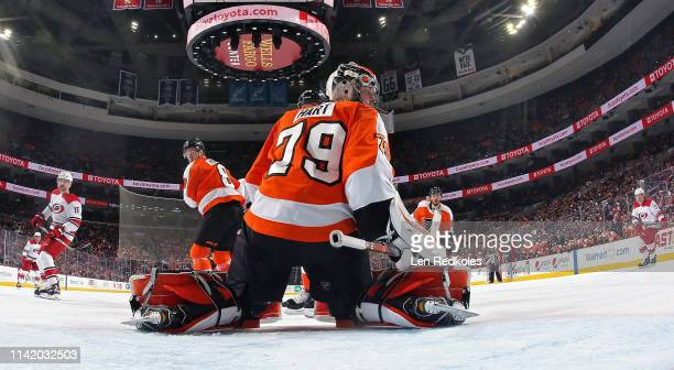 Carter Hart and members of the Philadelphia Flyers react to the play to the right of the net against the Carolina Hurricanes on April 6 2019 at the...