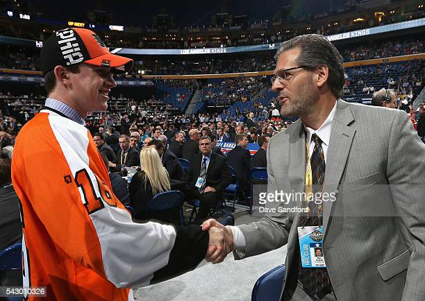 Carter Hart greets general manager Ron Hextall after being selected 48th overall by the Philadelphia Flyers during the 2016 NHL Draft at First...