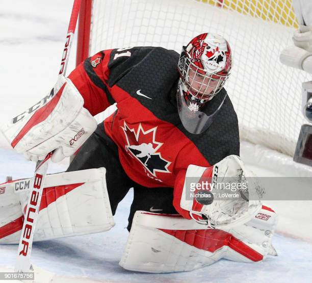 Carter Hart of Canada eyes the puck into his glove against team Sweden during the first period of play in the IIHF World Junior Championships Gold...