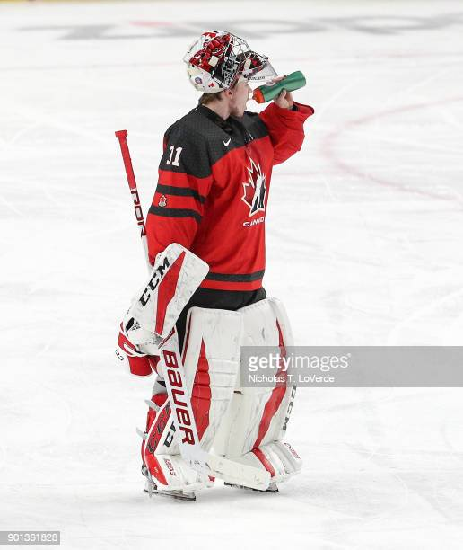 Carter Hart of Canada grabs a drink before heading to the bench for a timeout during the third period of play against the Czech Republic in the IIHF...