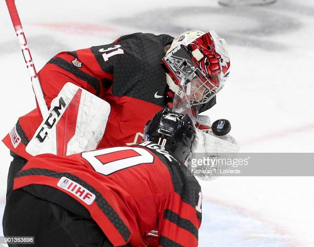 Carter Hart of Canada makes one of his 18 saves against the Czech Republic during the third period of play in the IIHF World Junior Championships...