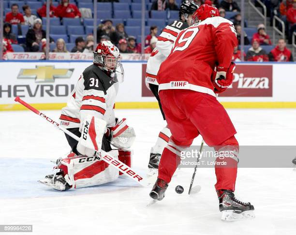 Carter Hart of Canada makes one of his 18 saves on a shot by Nikolaj Krag of Denmark during the second period of play in the IIHF World Junior...