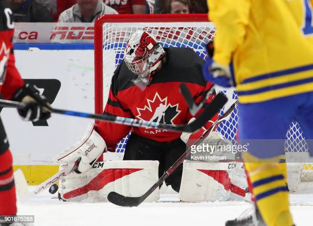 Carter Hart of Canada makes the save against a shot by Sweden during the Gold medal game of the IIHF World Junior Championship at KeyBank Center on...