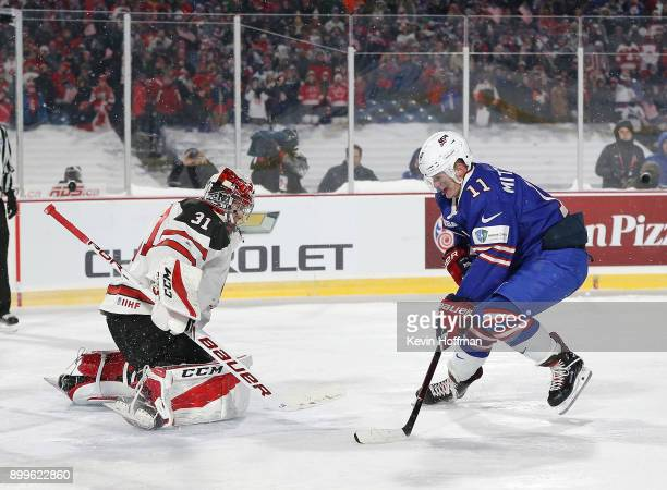 Carter Hart of Canada makes the save against Casey Mittelstadt of United States during the IIHF World Junior Championship at New Era Field on...