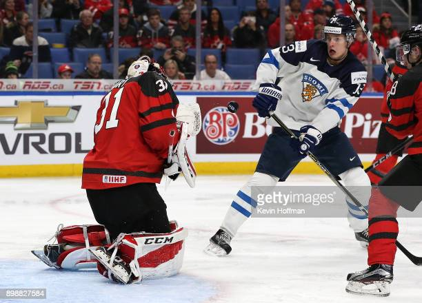 Carter Hart of Canada makes the save against Kristian Vesalainen of Finland during the second period at KeyBank Center on December 26 2017 in Buffalo...