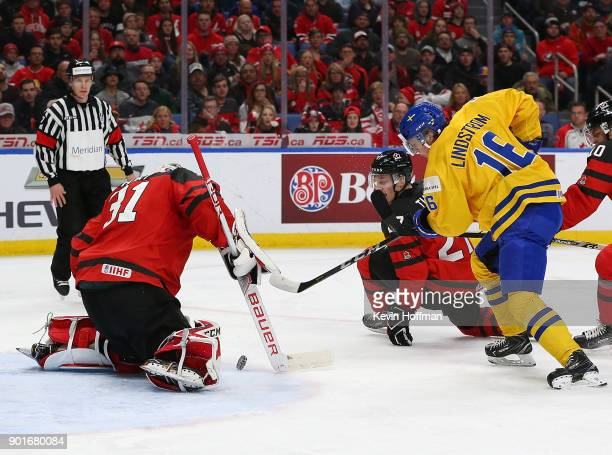 Carter Hart of Canada makes the save against Linus Lindstrm of Sweden in the second period during the Gold medal game of the IIHF World Junior...