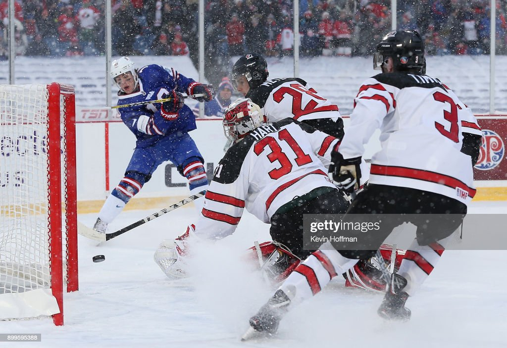 Carter Hart #31 of Canada makes the save against Will Lockwood #10 of United States in the first period during the IIHF World Junior Championship at New Era Field on December 29, 2017 in Buffalo, New York.