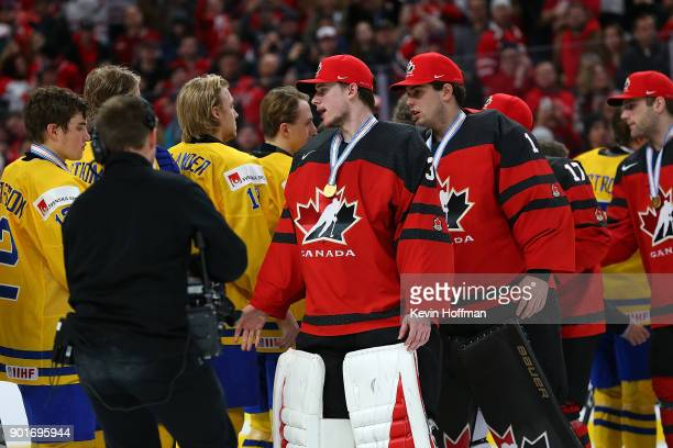 Carter Hart of Canada shakes hands with Team Sweden during the Gold medal game of the IIHF World Junior Championship at KeyBank Center on January 5...