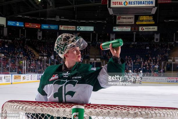 Carter Hart of the Everett Silvertips squirts water into the air as a superstitious ritual while standing in net against the Kelowna Rockets at...