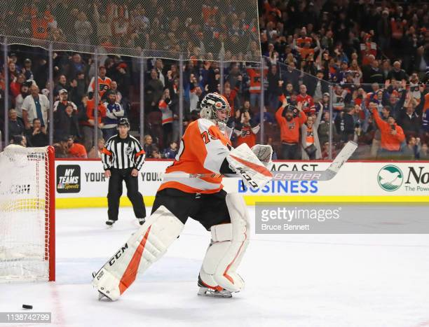 Carter Hart of the Philadelphia Flyers celebrates a 54 shootout victory over the Toronto Maple Leafs at the Wells Fargo Center on March 27 2019 in...