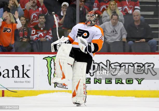 Carter Hart of the Philadelphia Flyers celebrates the win over the New Jersey Devils at Prudential Center on November 01 2019 in Newark New JerseyThe...