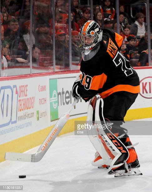 Carter Hart of the Philadelphia Flyers clears the puck in the first period against the Detroit Red Wings at Wells Fargo Center on February 16 2019 in...