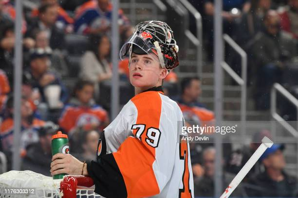 Carter Hart of the Philadelphia Flyers drinks water during the game against the Edmonton Oilers on October 16 at Rogers Place in Edmonton Alberta...