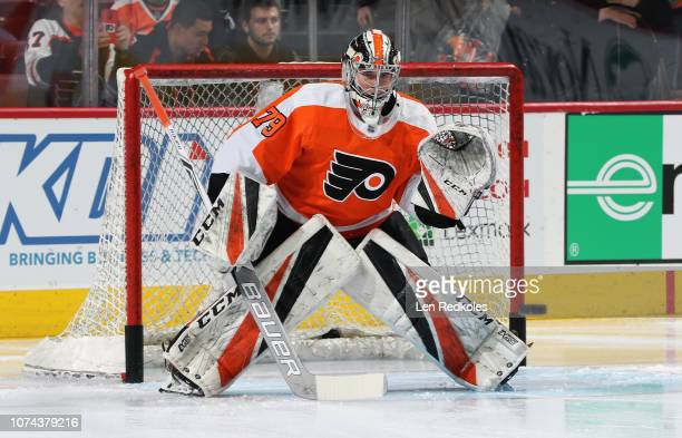 Carter Hart of the Philadelphia Flyers faces a shot during warmups prior to his game against the Detroit Red Wings on December 18 2018 at the Wells...