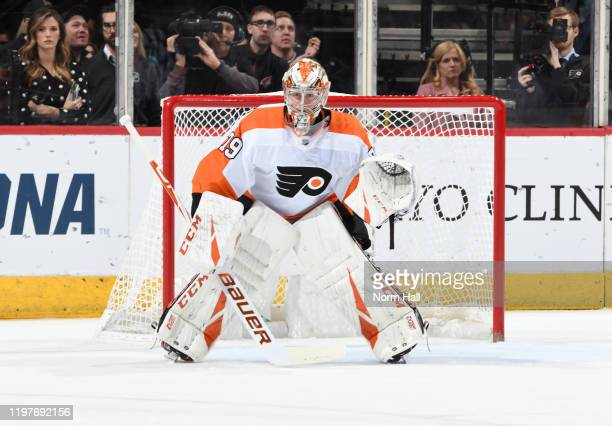 Carter Hart of the Philadelphia Flyers gets ready to make a save against the Arizona Coyotes at Gila River Arena on January 04 2020 in Glendale...
