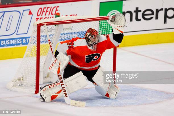 Carter Hart of the Philadelphia Flyers in action against the New Jersey Devils at the Wells Fargo Center on October 9 2019 in Philadelphia...