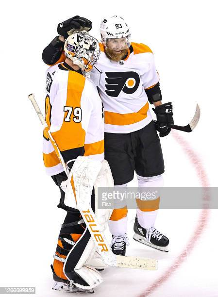 Carter Hart of the Philadelphia Flyers is congratulated by his teammate, Jakub Voracek after recording the shutout in his teams 1-0 win against the...