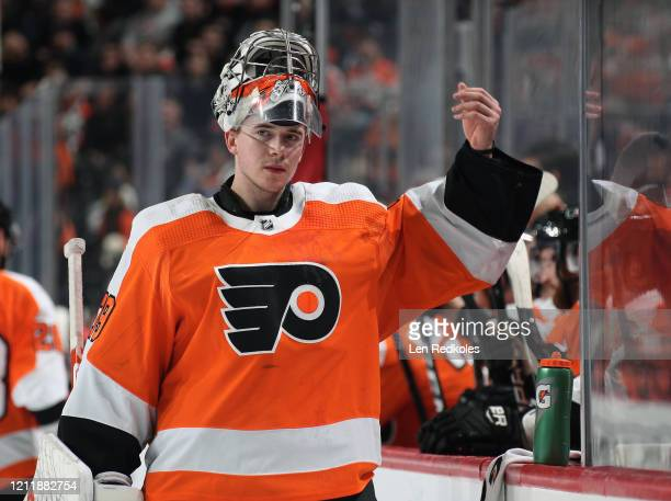Carter Hart of the Philadelphia Flyers lifts his goaltending mask during a timeout against the Carolina Hurricanes on March 5 2020 at the Wells Fargo...