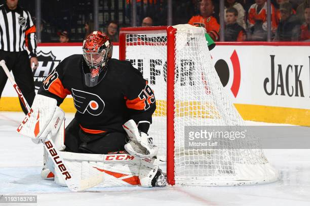 Carter Hart of the Philadelphia Flyers looks on against the Tampa Bay Lightning in the second period at the Wells Fargo Center on January 11 2020 in...