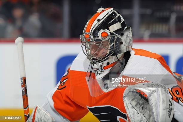 Carter Hart of the Philadelphia Flyers looks on against the Vancouver Canucks on February 4 2019 at the Wells Fargo Center in Philadelphia...