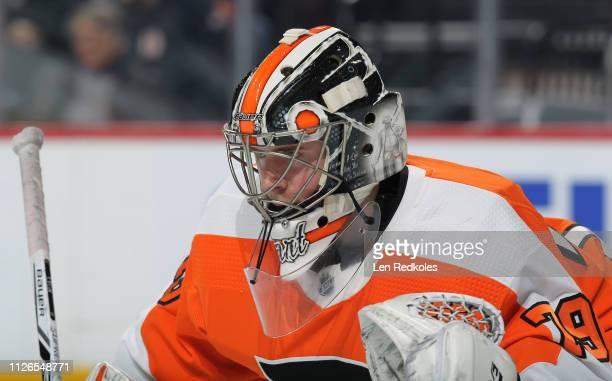 Carter Hart of the Philadelphia Flyers looks on against the Winnipeg Jets on January 28 2019 at the Wells Fargo Center in Philadelphia Pennsylvania