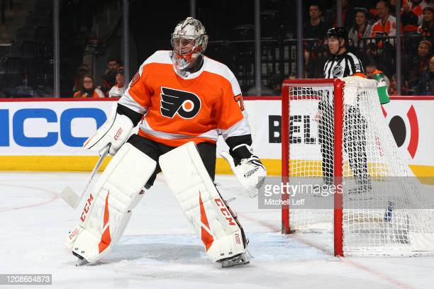 Carter Hart of the Philadelphia Flyers looks on against the Winnipeg Jets at the Wells Fargo Center on February 22 2020 in Philadelphia Pennsylvania