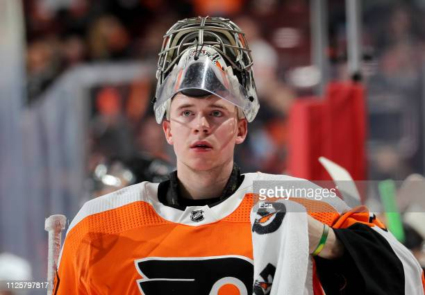 Carter Hart of the Philadelphia Flyers looks on during a stop in play in the first period against the Winnipeg Jets at Wells Fargo Center on January...