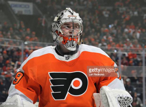 Carter Hart of the Philadelphia Flyers looks on during a stoppage in play against the Boston Bruins on March 10 2020 at the Wells Fargo Center in...