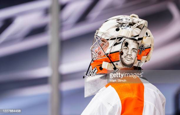 Carter Hart of the Philadelphia Flyers looks on during the third period against the Boston Bruins in a Round Robin game during the 2020 NHL Stanley...