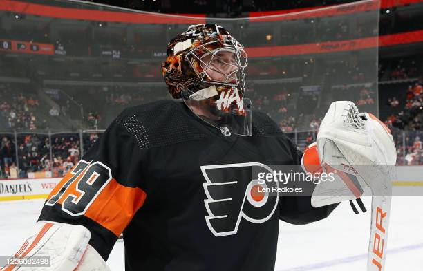 Carter Hart of the Philadelphia Flyers looks on during warmups prior to his game against the Florida Panthers at the Wells Fargo Center on October...