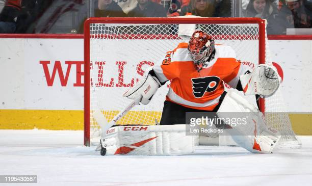 Carter Hart of the Philadelphia Flyers makes a pad save against the Anaheim Ducks on December 17 2019 at the Wells Fargo Center in Philadelphia...
