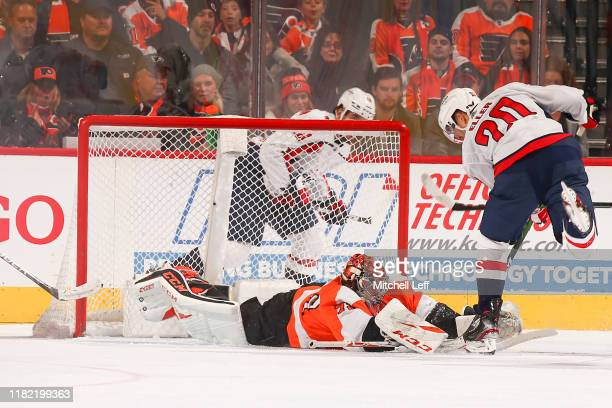 Carter Hart of the Philadelphia Flyers makes a save against Lars Eller of the Washington Capitals in the third period at Wells Fargo Center on...