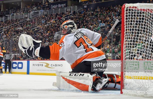 Carter Hart of the Philadelphia Flyers makes a save against the Pittsburgh Penguins at PPG Paints Arena on March 17 2019 in Pittsburgh Pennsylvania