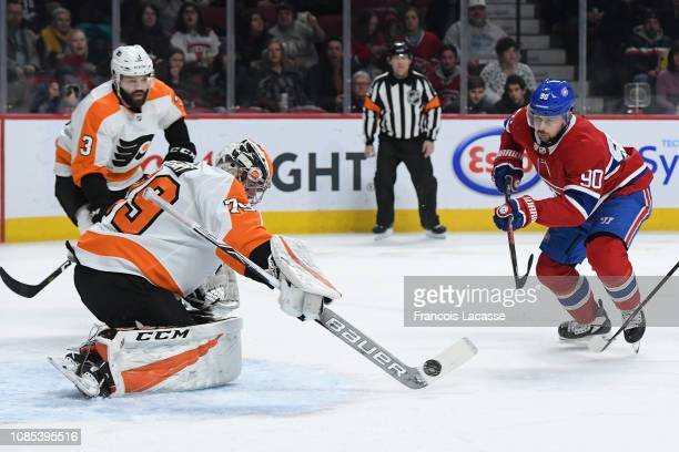 Carter Hart of the Philadelphia Flyers makes a save on a shot by Tomas Tatar of the Montreal Canadiens in the NHL game at the Bell Centre on January...