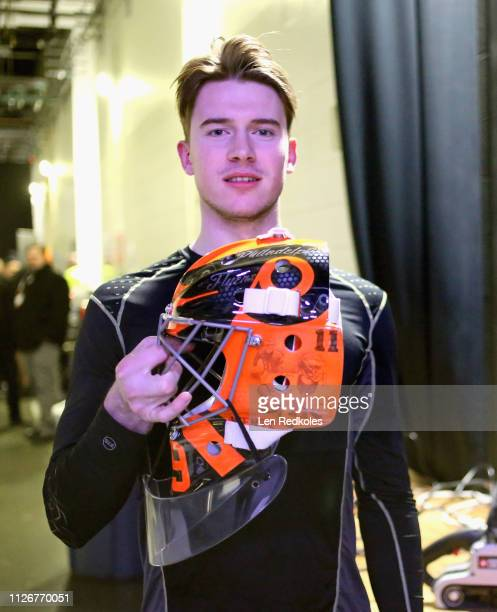 Carter Hart of the Philadelphia Flyers poses with his new helmet prior to his practice in preparation for the 2019 Coors Light NHL Stadium Series...