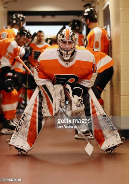 Carter Hart of the Philadelphia Flyers prepares to lead his team onto the ice for warmups prior to his game against the Detroit Red Wings on December...